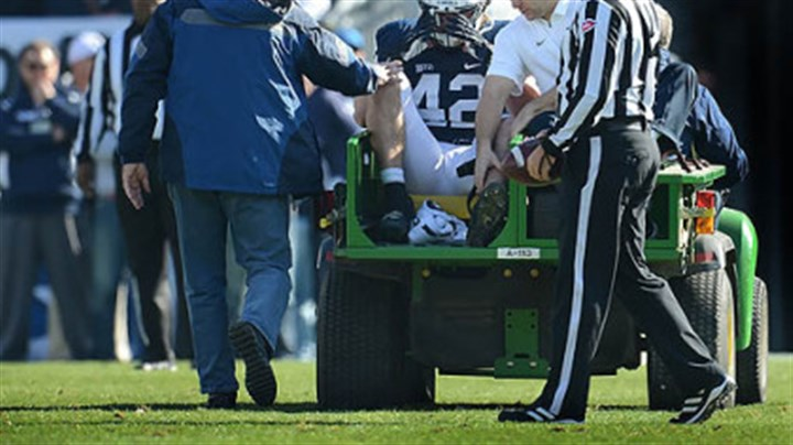 mauti injured Penn State linebacker Michael Mauti clutches his helmet after injuring his left knee in the first half against Indiana at Beaver Stadium, State College on Nov. 17.