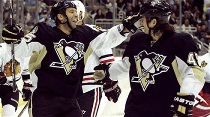 Max Talbot and Arron Asham Penguins forward Max Talbot, left, celebrates a goal with teammate Arron Asham.