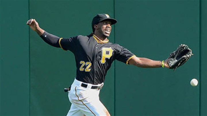McCutchen Pirates center fielder Andrew McCutchen cannot run down a ball hit Sunday by the Reds' Miguel Cairo for a double.