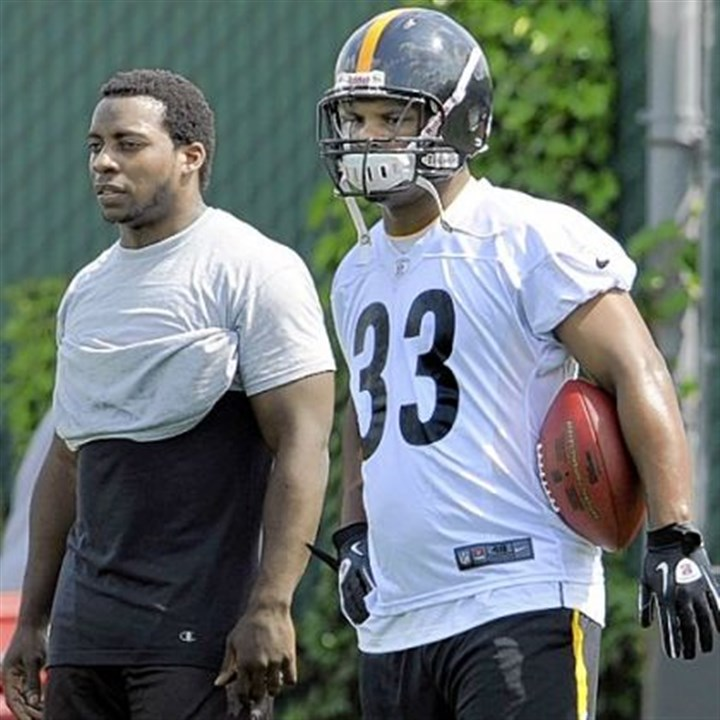 Mendenhall The pressure is on Isaac Redman, right, and Rashard Mendenhall to help the Steelers develop a balanced offense -- something they haven't had this season.