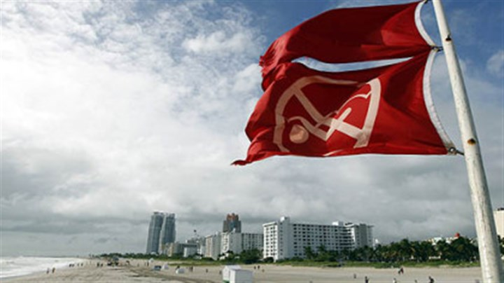 miami flag hurricane windy Red flags fly from a lifeguard station as Hurricane Sandy passes east of Miami Beach today. Sandy could blend with a winter storm and reach the East Coast as a super-storm next week.