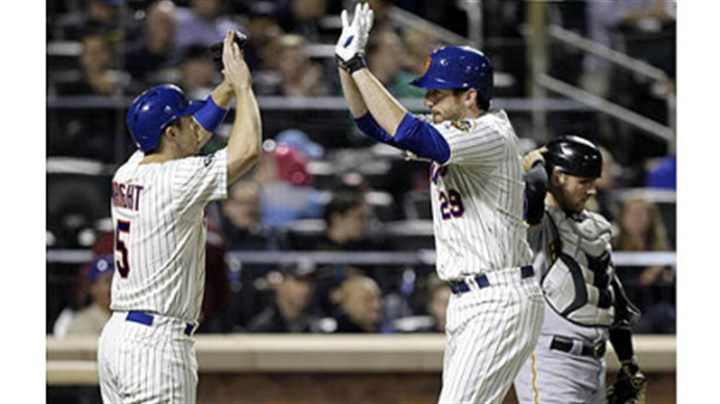 Michael McKenry The Mets' David Wright, left, greets Ike Davis at the plate as Pirates catcher Michael McKenry adjusts his helmet after Wright scored on an Ike Davis two-run home run in the fourth inning.