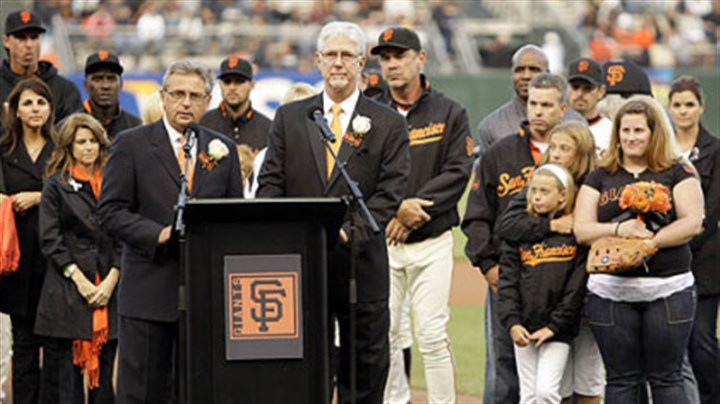 Mike Krukow and Duane Kuiper Giants announcers Mike Krukow, right of podium, and Duane Kuiper lead a pre-game tribute to Sue Burns, a part owner of the Giants who lost her battle with cancer.