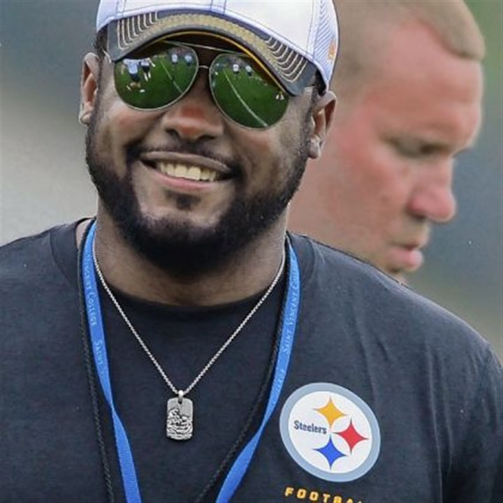 Mike Tomlin Steelers head coach Mike Tomlin jokes with players during the second day of camp.