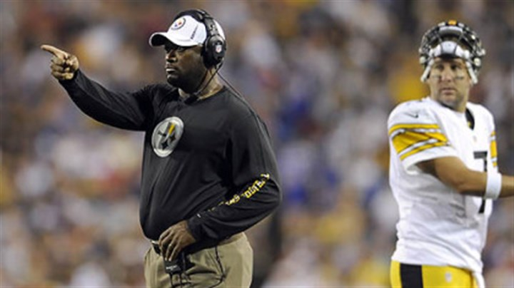 Mike Tomlin Steelers head coach Mike Tomlin signals to his team against Buffalo in the second quarter.