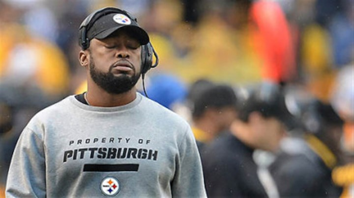 Mike Tomlin eyes closed Head coach Mike Tomlin reacts after the Steelers fumble to the Chargers in the end zone for a touchdown.