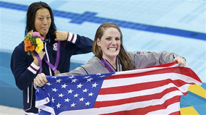 Missy Franklin United States gold medalist Missy Franklin holds a national flag at a medal ceremony with Japan's silver medalist Aya Terakawa after the women's 200-meter freestyle swimming semifinal Monday.