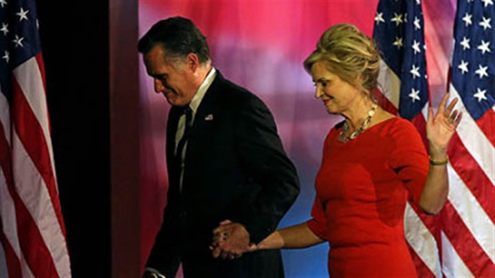 Mitt Romney Republican presidential candidate Mitt Romney and his wife, Ann, walk off of the stage after conceding the presidency during Mitt Romney's election night event at the Boston Convention & Exhibition Center in Boston, Mass.