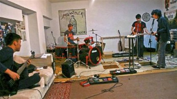 "Mohanik Mohanik in their practice space going over ""Johnny B. Goode"" before a performance, From left: Enerelt, Bagi, Dawaa, Tsojo."