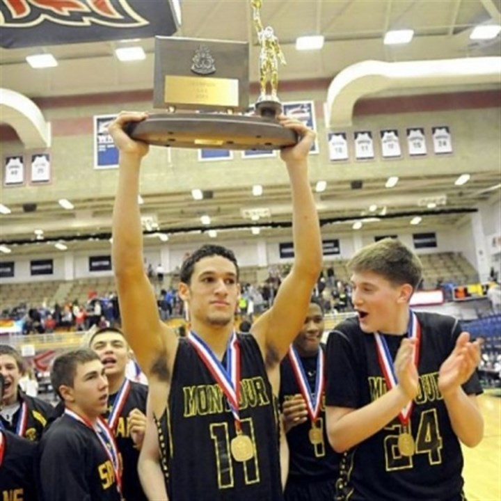 Montour Montour's Devin Wilson holds the trophy after defeating Chartiers Valley in the WPIAL Class AAA championship last Friday night.