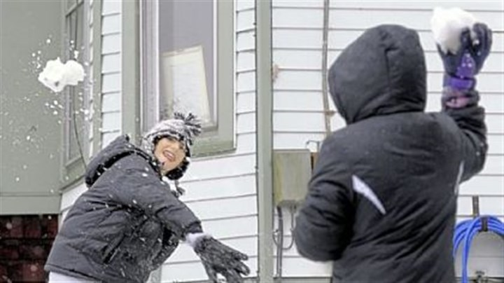 Morgantown Joshua Bryant, 13 and his sister Dakota Caldwell, 9, have a snowball fight at their front yard in Morgantown today. They moved from San Antonio, Texas, in August and today is their first time playing in the snow.