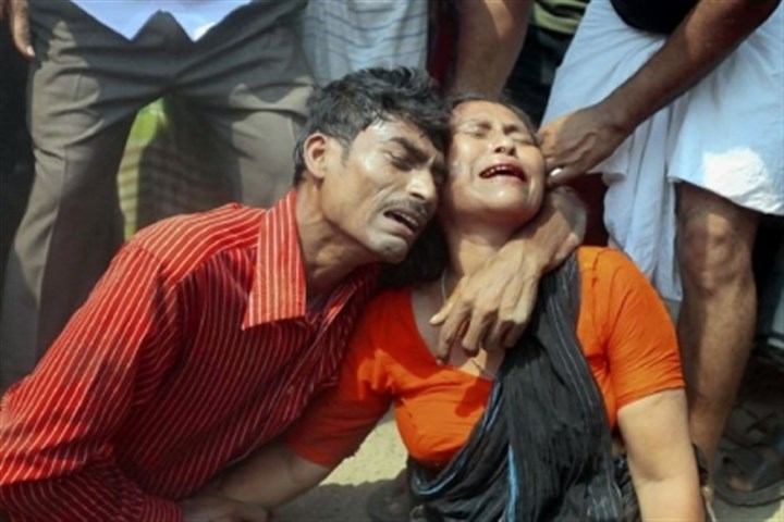 Mourn Relatives mourn a victim Wednesday at the site where an eight-story building, which housed several garment factories, collapsed in the town of Savar, near Dhaka, Bangladesh. The building collapse killed at least 149 people and trapped many more in the rubble, officials said.