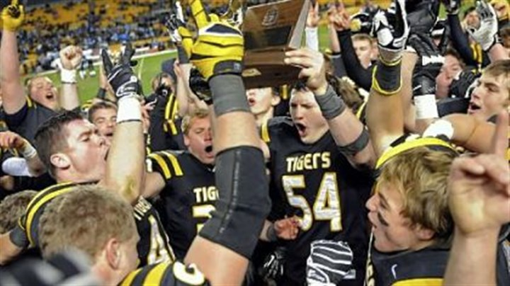 NA celebrates North Allegheny players celebrate their win Friday against Woodland Hills in the WPIAL Class AAAA championship at Heinz Field.
