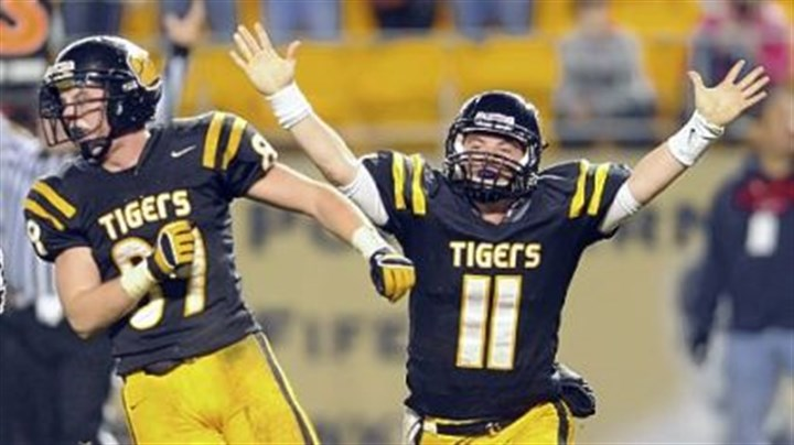 NA Tigers North Allegheny quarterback Mack Leftwich (11), with Jack Henderson, threw for more than 2,000 yards last season.