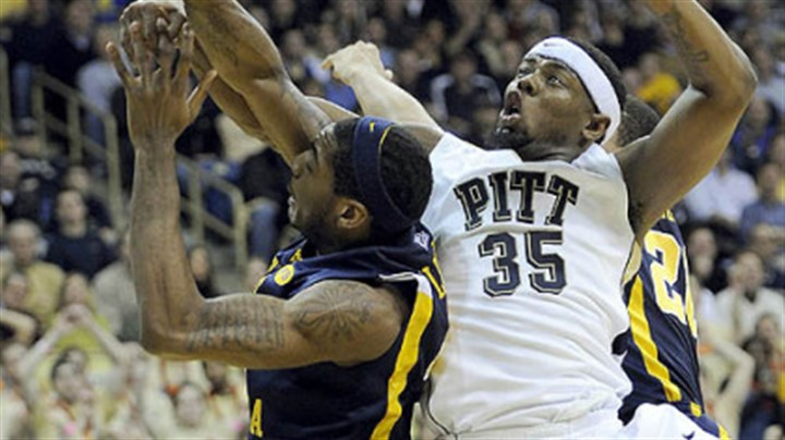 Nasir Robinson and John Flowers Pitt forward Nasir Robinson gets tangled up with West Virginia forward John Flowers in the first half.