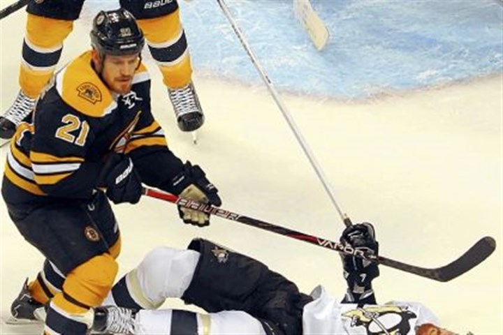 neal James Neal hits the ice after being hit by Boston's Andrew Ference Wednesday night in Game 3 in Boston, a game the Bruins pulled out in the second overtime.