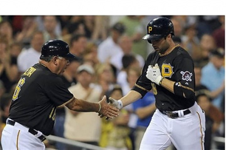 Neil Walker and Nick Leyva The Pirates' Neil Walker is congratulated by third base coach Nick Leyva after hitting a home run in the third inning against the Cardinals Wednesday night at PNC Park.