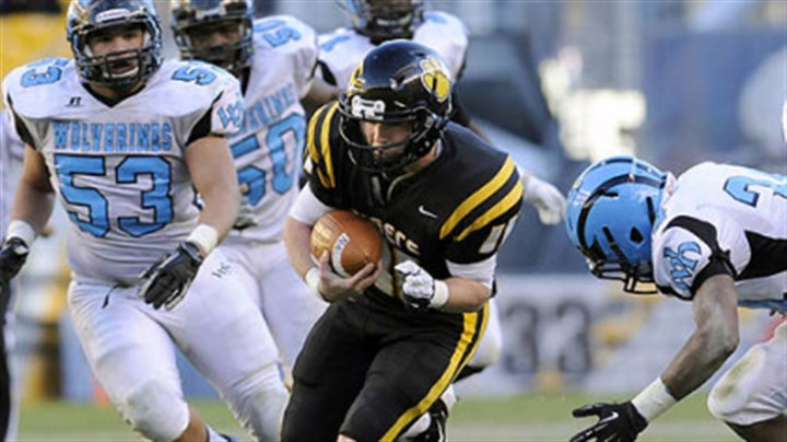 North Allegheny quarterback Mack Leftwich North Allegheny quarterback Mack Leftwich carries against Woodland Hills Friday in the WPIAL class AAAA championships at Heinz Field.