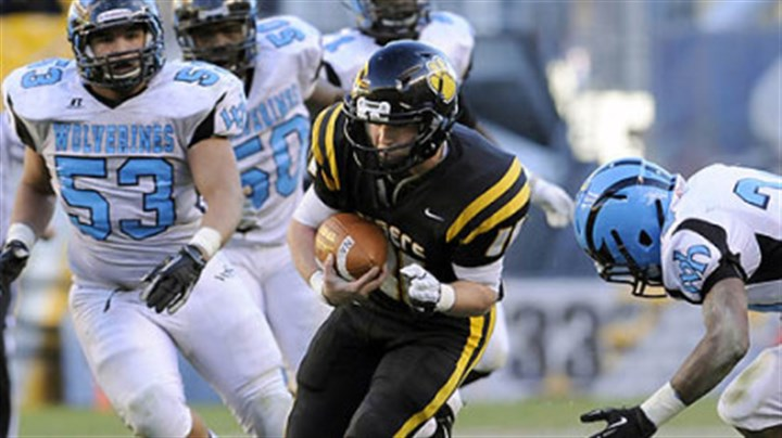 North Allegheny quarterback Mack Leftwich North Allegheny quarterback Mack Leftwich carries against Woodland Hills Friday in the WPIAL Class AAAA championship at Heinz Field.