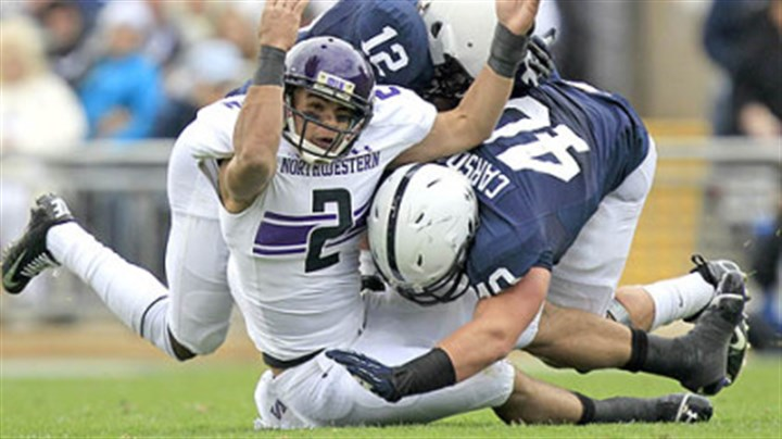 Northwestern quarterback sacked Northwestern quarterback Kain Colter is tackled by Penn State cornerback Stephon Morris and linebacker Glenn Carson (40) as he attempts to catch a pass during the second quarter of today's game in State College.
