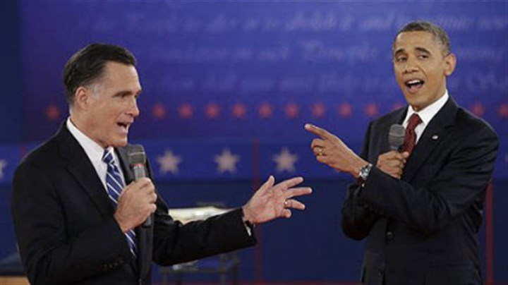 Obama and Romney President Barack Obama and Republican presidential nominee Mitt Romney exchange views during the second presidential debate.