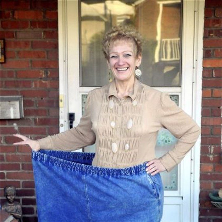 Old jeans Beth Walley, now about 160 pounds, shows off an old set of jeans she wore when she weighed 450 pounds.