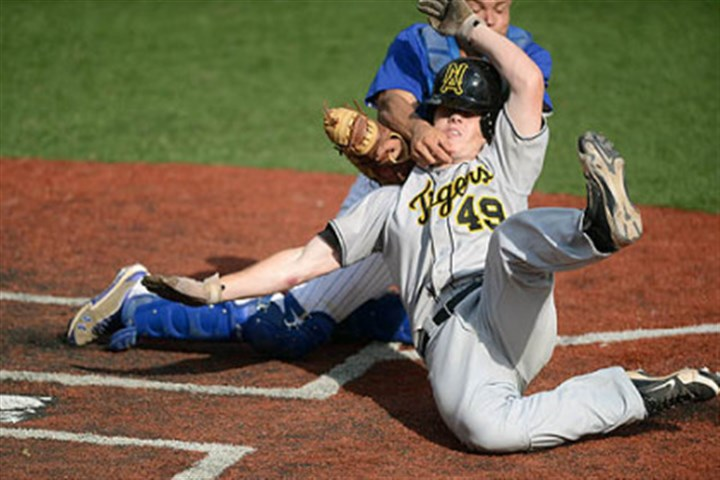 Out at the plate North Allegheny's Matt Waugaman is tagged out at home plate by Lower Dauphin catcher Deon Stafford after going for an inside-the-park home run.