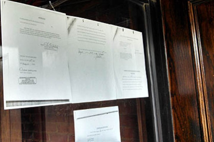 paperz on levelz door The notice from the Allegheny County District Attorney's office on the door of Levelz.