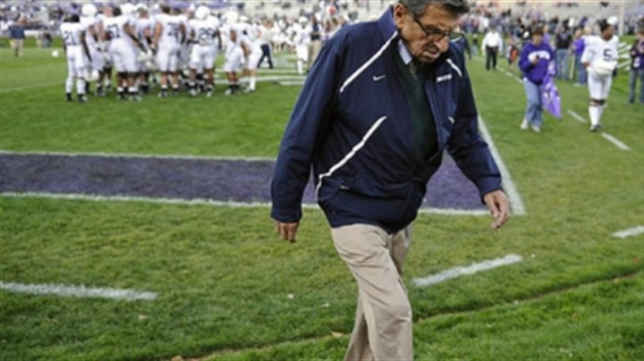 paterno walking file In this file photo taken Oct. 22, 2011, Penn State coach Joe Paterno walks off the field after warmups before Penn State's NCAA college football game against Northwestern in Evanston, Ill.