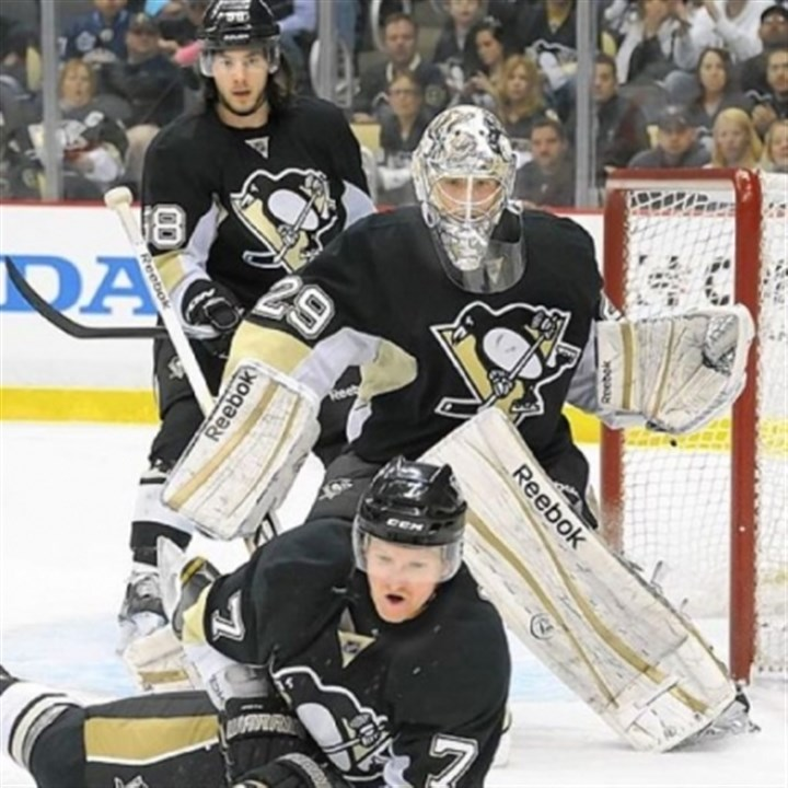PaulMartin Penguins defenseman Paul Martin makes a save in front of goalie Marc-Andre Fleury.