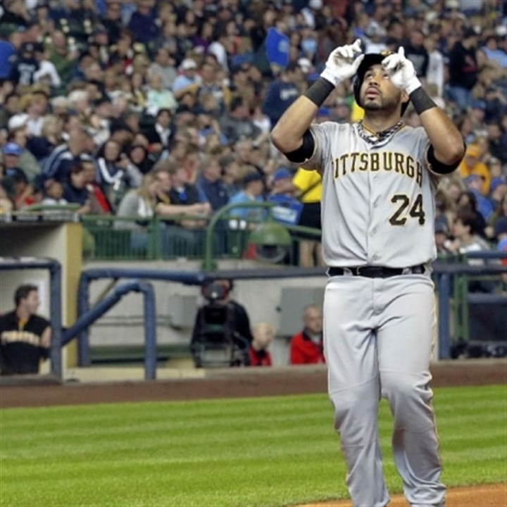 pedro Pedro Alvarez gestures before crossing home plate after hitting the first of his two home runs in the Pirates' 5-2 win Saturday at Miller Park in Milwaukee.