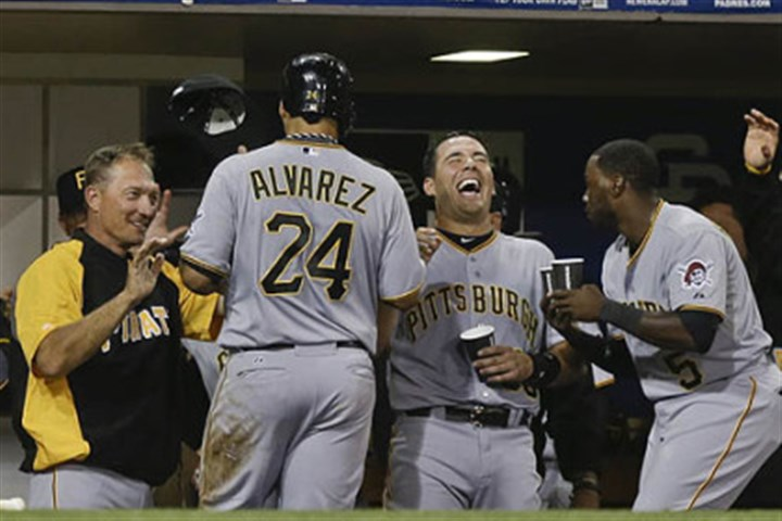 Pedro Alvarez Pedro Alvarez is congratulated at the dugout after he singled then scored on a three-base error by Padres right fielder Chris Denorfia in the fourth inning.