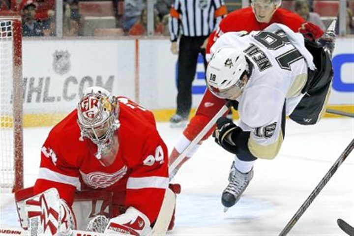 Penguins-2 Detroit Red Wings goalie Petr Mrazek stops a shot as Penguins left winger James Neal goes after the a rebound in the first period Wednesday night.