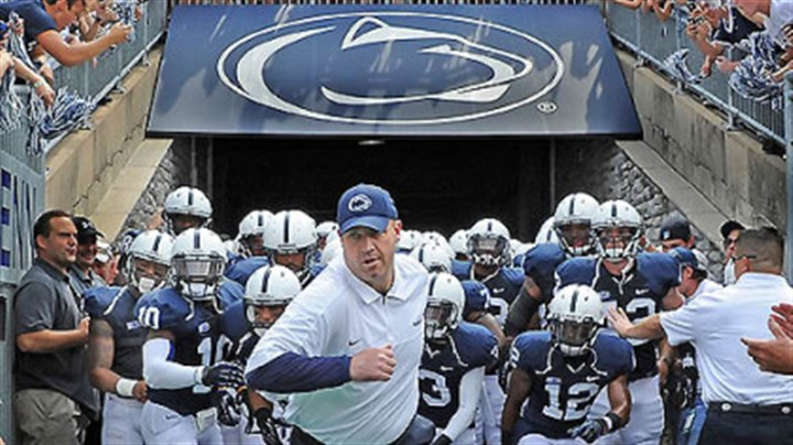 Penn State head coach Bill O'Brien Penn State head coach Bill O'Brien leads the Nittany Lions out onto the field at Beaver Stadium at the start of their game against Ohio University this afternoon in State College.
