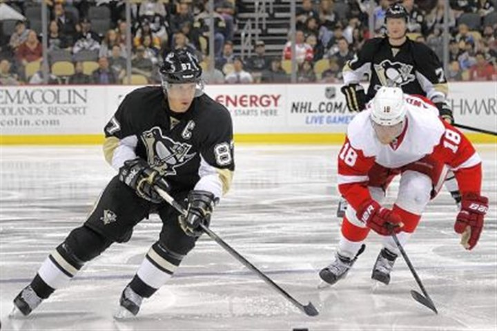 pens1 Sidney Crosby skates toward the goal against the Red Wings' Joakim Andersson in the Penguins' first preseason home game Monday at Consol Energy Center. The Penguins lost, 4-1.