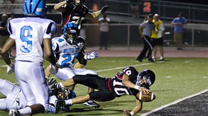 Pete Coughlin Gail Witenske shared this photo of Upper St. Clair senior quarterback Pete Coughlin diving into the end zone for a fourth-quarter touchdown against Woodland Hills on Aug. 31. Upper St. Clair won the game, 31-12.