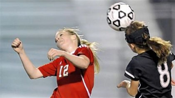 Peters Soccer Peters Township's Veronica Latsko, left, battles for loose ball against Upper St. Clair's Megan Hindman fight for the ball in November. Latsko, the Post-Gazette's girls player of the year, led Peters Township with 45 goals in 2011.