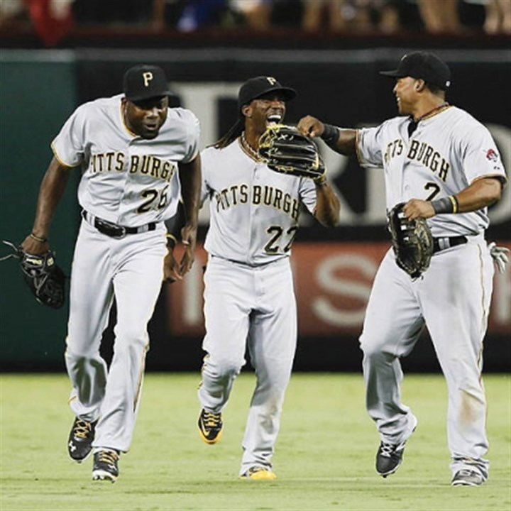 pirates celebrate win 82 Felix Pie, Andrew McCutchen, and Marlon Byrd celebrated last night, after their 82nd win of the 2013 season.