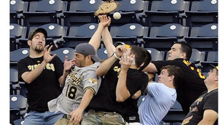 Pirates fans Pirates fans try to catch a home run ball hit by Washington's Wilson Ramos in the third inning Tuesday night at PNC Park.