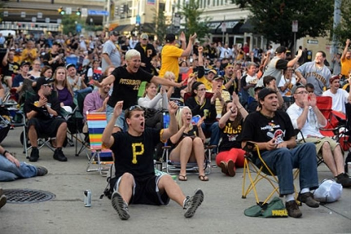 Pirates fans Pirates fans gather on Federal Street outside PNC Park to watch the game.