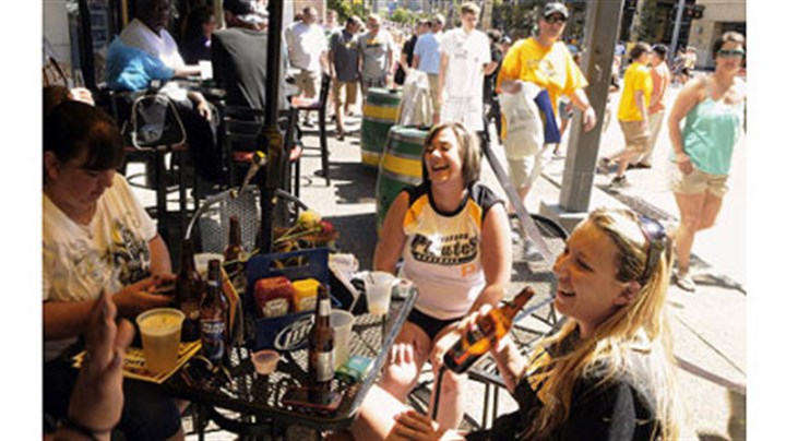 pirates merch day 2 Pirates fans have been supporting the businesses around PNC Park. This group celebrated at Mullens Bar & Grill on the North Shore.
