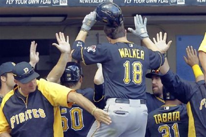 Pirates Neil Walker Pittsburgh Pirates Neil Walker is congratulated after hitting a three-run home run during the seventh inning of a baseball game against the Milwaukee Brewers Monday, Sept. 2, 2013, in Milwaukee.