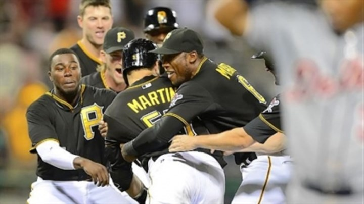 Pirates' Russell Martin Russell Martin is mobbed by teammates after his 11th-inning single brought home the winning run.
