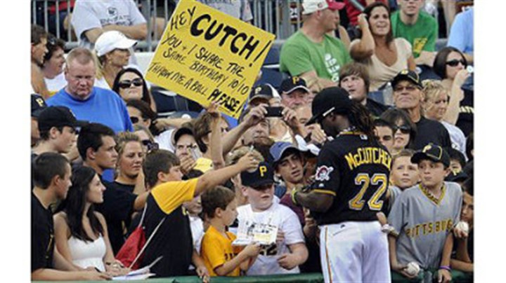 pirates vs. cubs Pirates' Andrew McCutchen signs autographs before the start of the game against the Cubs Tuesday night.