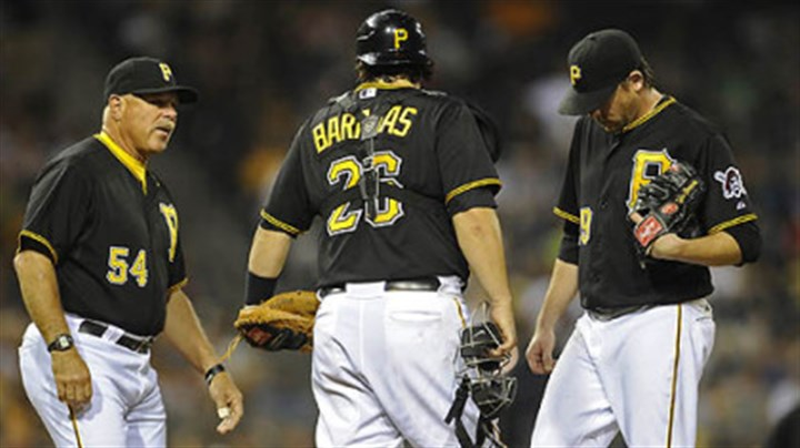 pitching Pirates starting pitcher Kevin Correia gets a visit to the mound from pitching coach Ray Searage in the sixth inning Tuesday night at PNC Park.
