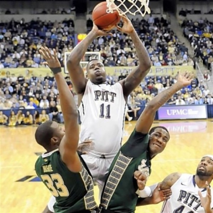 Pitt Dante Taylor drives to the basket between South Florida's Kore White and Victor Rudd Wednesday night at Petersen Events Center. Taylor had 12 points -- his first time in double figures in 19 games.