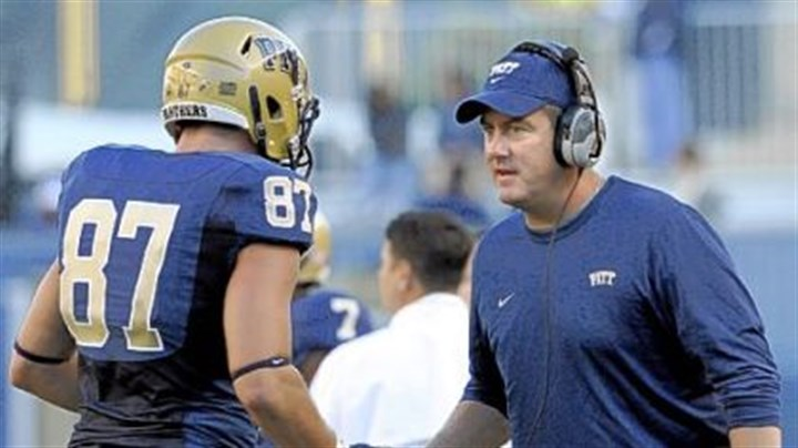 Pitt Pitt head coach Paul Chryst congratulates Mike Shanahan after scoring a touchdown against Gardner-Webb Sept. 22 at Heinz Field.