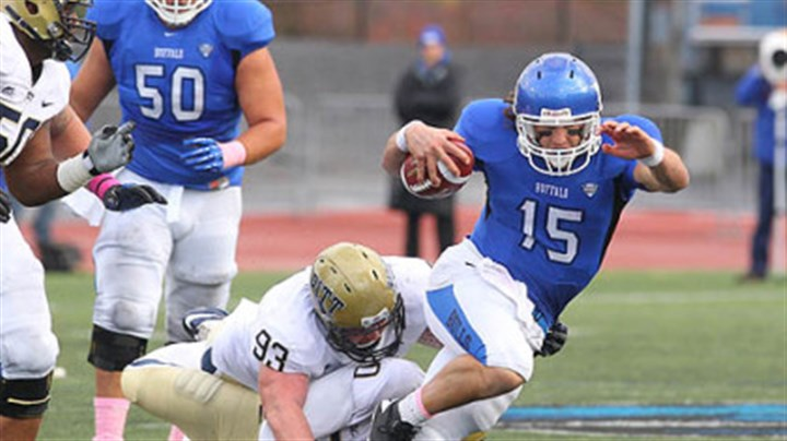 Pitt vs. Buffalo Pitt's Bryan Murphy, top, and T.J. Clemmings trip up Buffalo's Alex Zordich in the first half Saturday in the Panthers' non-conference win in Amherst, N.Y.