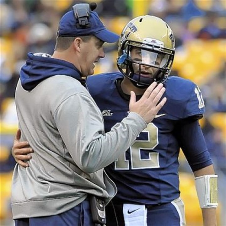 pittfb Pitt head coach Paul Chryst talks with quarterback Tino Sunseri near the end of the second quarter against Temple at Heinz Field Saturday.