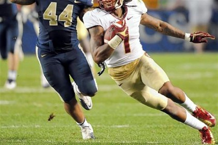 Pittfb3 Florida State''s Kelvin Benjamin carries in front of Pitt''s Shane Gordon in the third quarter at Heinz field Monday night.